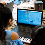 Students playing their latest track for the tutor